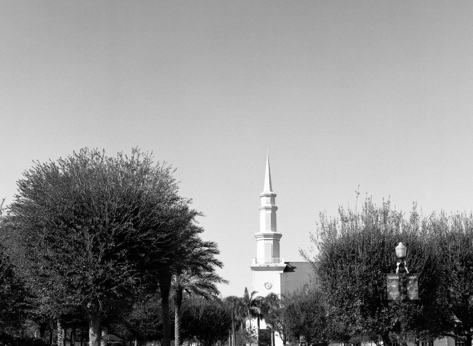 A church in the distance with a white steeple